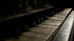 6993383-old-piano-music-photo